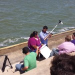 Shooting on location at the sea wall in Corpus Christi.