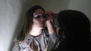 Photographer and makeup artist Beth Marie Cantu putting makeup on Katherine Orozco during the first photo shoot.