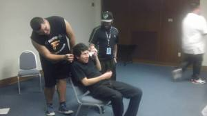 "Trujillo being punished by audience members in ""Penalty Hat"" in a recent Premature Punchline performance."